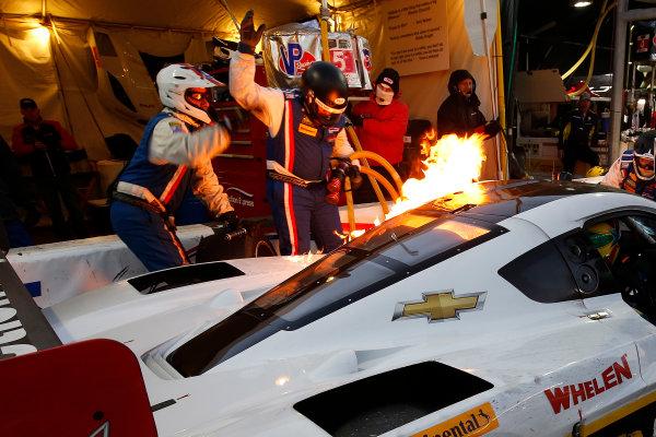 21-25 January, 2015, Daytona Beach, Florida USA  5, Chevrolet, Corvette DP, P, Joao Barbosa, Christian Fittipaldi, Sebastien Bourdais pit stop fire ©2015, Michael L. Levitt LAT Photo USA