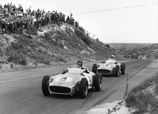 Zandvoort, Holland. 19th June 1955.Juan Manuel Fangio (Mercedes-Benz W196),1st position, leads Stirling Moss (Mercedes-Benz W196), 2nd position, action.World Copyright: LAT Photographic.Ref: Autocar Used Pic 24th June 1955 Pg 877.