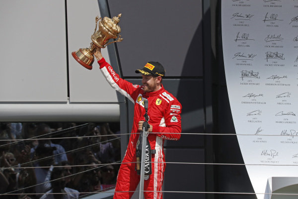 Sebastian Vettel (GER) Ferrari with the champagne and the trophy