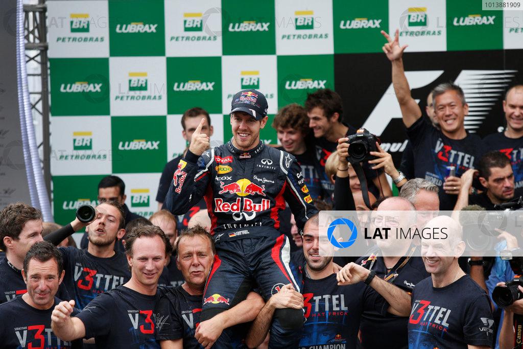 Interlagos, Sao Paulo, Brazil. Sunday 25th November 2012. 2012 World Champion Sebastian Vettel, Red Bull RB8 Renault, celebrates with the Red Bull team. World Copyright:Charles Coates/LAT Photographic ref: Digital Image _N7T8292