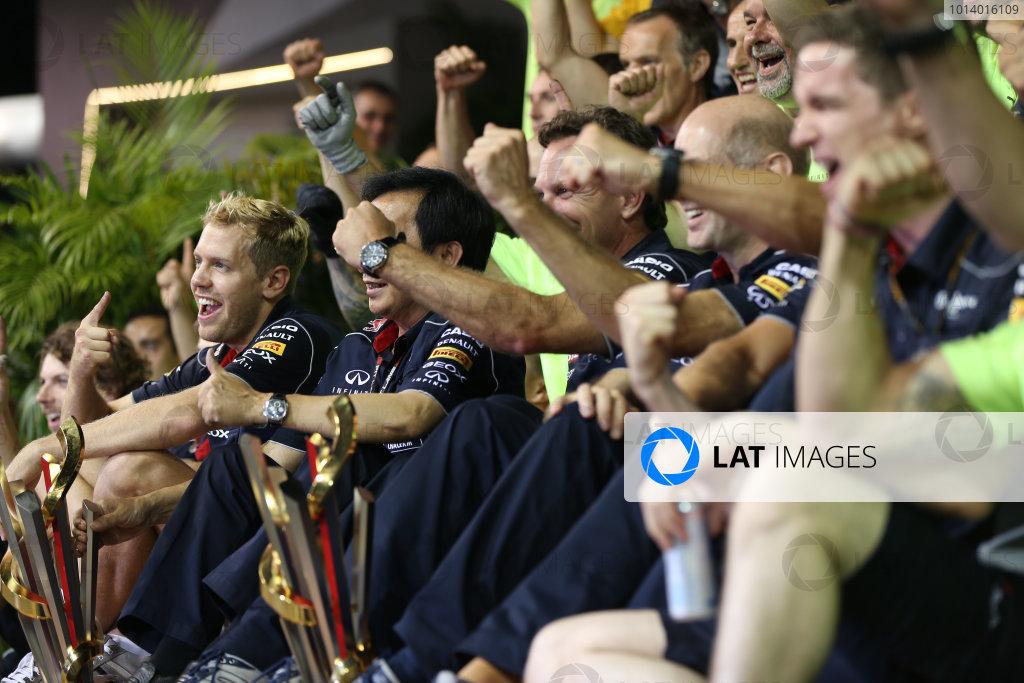 Marina Bay Circuit, Singapore. Sunday 22nd September 2013.  Sebastian Vettel in the Red Bull Racing team celebration photo.  World Copyright: Andy Hone/LAT Photographic. ref: Digital Image HONZ6157