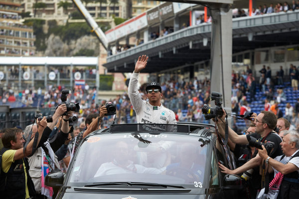 Monte Carlo, Monaco. Saturday 23 May 2015. Pole starter Lewis Hamilton, Mercedes AMG, is driven away from Parc Ferme after qualifying. World Copyright: Steve Etherington/LAT Photographic. ref: Digital Image SNE26588