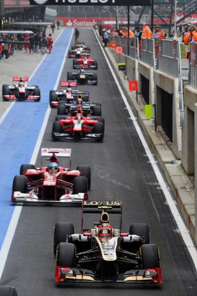 Romain Grosjean (FRA) Lotus E20 heads out of pit lane. Formula One World Championship, Rd9, British Grand Prix, Qualifying, Silverstone, England, Saturday 7 July 2012.
