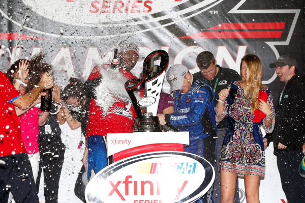20-21 November, 2015, Homestead, Florida USA Chris Buescher with the Xfinity Series Championship trophy ? 2015, Nigel Kinrade LAT Photo USA