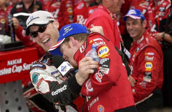 NASCAR Winston Cup Aaron's 499, Talladega Superspeedway, Talladega,Alabama, USA 6 April,2003Winner Dale Earnhardt,Jr. gets a hug and a soaking from Kevin Harvick in Victory Lane.-F Peirce Williams/LAT Photographic 2003