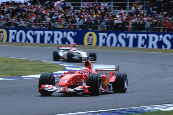 2004 British Grand PrixSilverstone England. 9th - 11th July.Rubens Barrichello, Ferrari F2004 leads Jenson Button, BAR Honda 006. Action. World Copyright:Peter Spinney/LAT Photographic Ref:35mm image A10