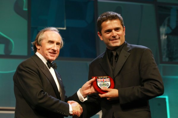 2003 AUTOSPORT AWARDS, The Grosvenor, London. 7th December 2003.Gil De Ferran receives Honorary membership to the BRDC from Sir Jackie Stewart.Photo: Peter Spinney/LAT PhotographicRef: Digital Image only