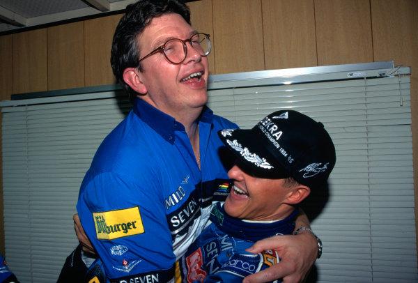 1995 Japanese Grand Prix Suzuka, Japan. 27th - 29th October. Michael Schumacher and Ross Brawn celebrate. World Copyright:LAT Photographic Ref:35mm Image