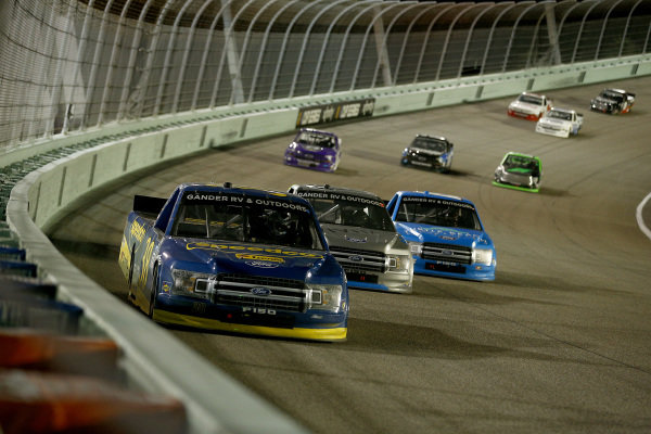 Todd Gilliland, Front Row Motorsports Ford SpeedCo Ford, leads a pack of cars, Copyright: Michael Reaves/Getty Images.