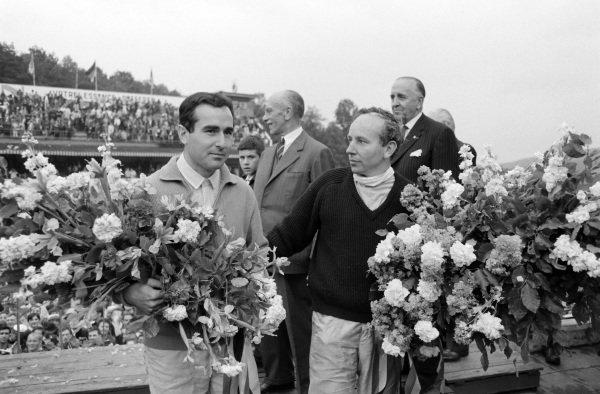 Race winner John Surtees with teammate Lorenzo Bandini, 3rd position, on the podium.