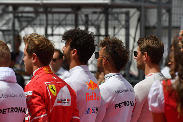 Drivers observe the National Anthem on the grid at Formula One World Championship, Rd9, Austrian Grand Prix, Race, Spielberg, Austria, Sunday 9 July 2017.