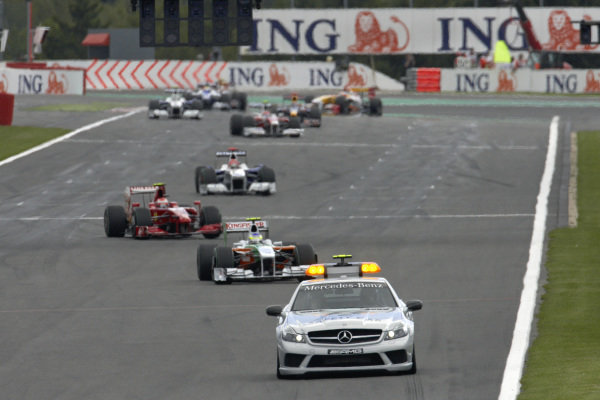 Giancarlo Fisichella, Force India VJM02 Mercedes leads Kimi Räikkönen, Ferrari F60 and Robert Kubica, BMW Sauber F1.09 behind the safety car.