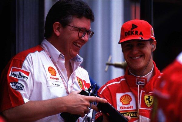 1998 Monaco Grand Prix. Monte Carlo, monaco. 21-24 May 1998. Ferrari Technical Director Ross Brawn with Michael Schumacher (Ferrari). World Copyright - Tee/LAT Photographic
