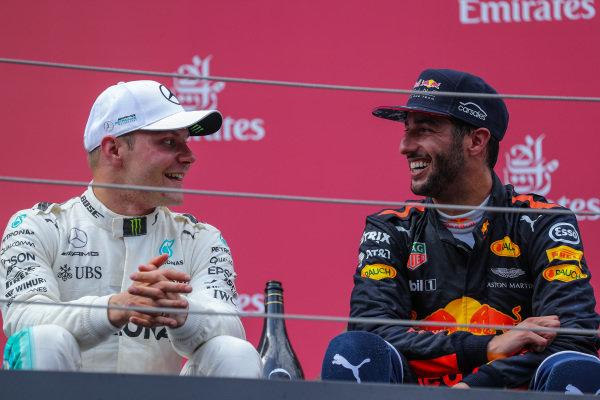race winner Valtteri Bottas (FIN) Mercedes AMG F1 and Daniel Ricciardo (AUS) Red Bull Racing celebrate on the podium at Formula One World Championship, Rd9, Austrian Grand Prix, Race, Spielberg, Austria, Sunday 9 July 2017.
