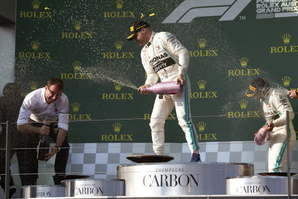 Valtteri Bottas, Mercedes AMG F1, 1st position, and Lewis Hamilton, Mercedes AMG F1, 2nd position, spray Champagne on the podium