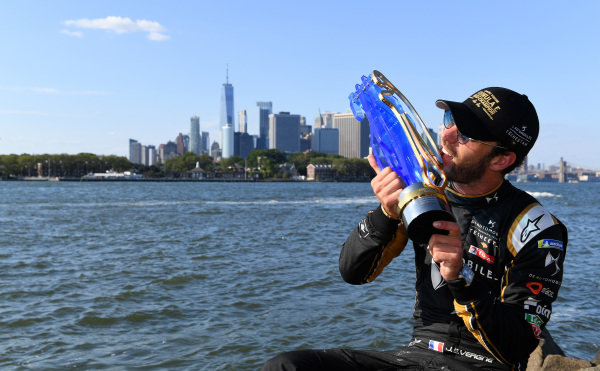 Jean-Eric Vergne (FRA), DS TECHEETAH, with his championship trophy overlooking New York