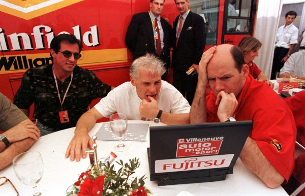 1998 Monaco Grand Prix.Monte Carlo, monaco.21-24 May 1998.Jacques Villeneuve (Williams Mecachrome), race engineer Jock Clear and movie star Sylvester Stallone check the morning practice times.World Copyright - LAT Photographic