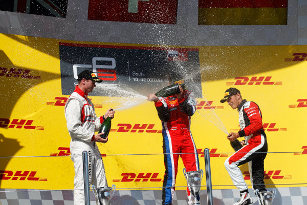 2014 GP3 Series. Round 8.   Sochi Autodrom, Sochi, Russia. Sunday Race 2 Sunday 12 October 2014. Dean Stoneman (GBR, Marussia Manor Racing), Patric Niederhauser (SUI, Arden International) amd Marvin Kirchhofer (GER, ART Grand Prix) spray the champagne on the podium. Photo: Sam Bloxham/GP3 Series Media Service. ref: Digital Image _G7C7719