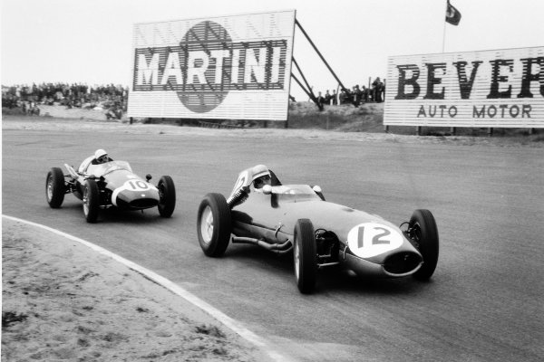 1959 Dutch Grand Prix Zandvoort, Holland. 31 May 1959 Innes Ireland, Lotus 16-Climax, 4th position, leads Maurice Trintignant, Cooper T51-Climax, 8th position World Copyright: LAT PhotographicRef: Autosport b&w print. Published: Autosport, 5/6/1959 p728