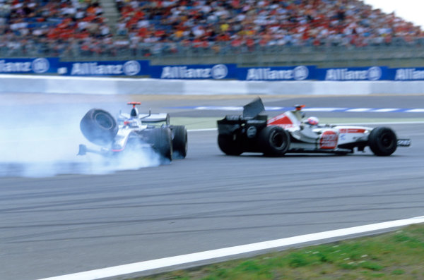 2005 European Grand Prix - Sunday Race Nurburgring, Germany 29th May 2005Kimi Raikkonen, McLaren Mercedes MP4-20, crashes into the tyre wall after his front right tyre tore away from the car, shattering the wishbone World Copyright: Steven Tee/LAT Photographic ref: 35mm 50mb Scan 05EuropeC03