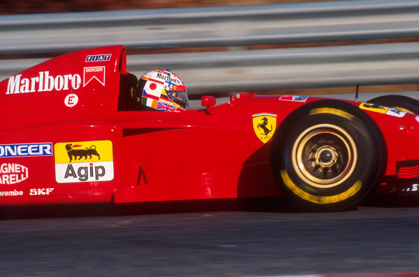 """Estoril, Portugal.22-24 September 1995.Gerhard Berger (Ferrari 412T2) 4th position. He wore a different crash helmet as part of a competition run by an Italian newspaper. The winning design was called """"No war in the World"""". Berger was only supposed to wear it on Friday, but he liked it so much that he wore it all weekend.Ref-95 POR 16.World Copyright - LAT Photographic"""