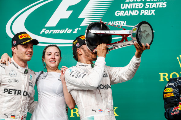 Circuit of the Americas, Austin Texas, USA. Sunday 23 October 2016. Lewis Hamilton, Mercedes AMG, 1st Position, drinks from his trophy. World Copyright: Glenn Dunbar/LAT Photographic ref: Digital Image _31I5248