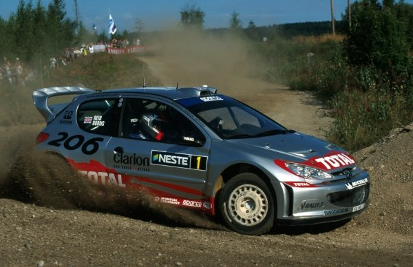 Richard Burns (GBR) Peugeot 206 WRC.FIA World Rally Championship, Rd9, Neste Rally Finland, Finland. 8-11 August 2002.BEST IMAGE