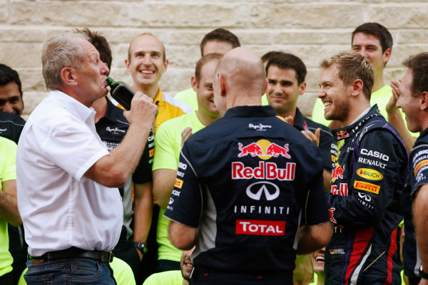 Circuit of the Americas, Austin, Texas, United States of America. Sunday 17th November 2013.  Helmut Markko, Advisor, Red Bull, downs some Jagermeister with Sebastian Vettel, Red Bull Racing, 1st position, and Adrian Newey, Chief Technical Officer, Red Bull Racing, at the post race team celebrations. World Copyright: Alastair Staley/LAT Photographic. ref: Digital Image _R6T1153