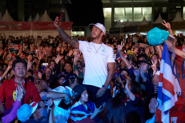 Suzuka Circuit, Japan. Saturday 7 October 2017. Lewis Hamilton, Mercedes AMG, joins a huge gathering of fans. World Copyright: Steve Etherington/LAT Images  ref: Digital Image SNE15380