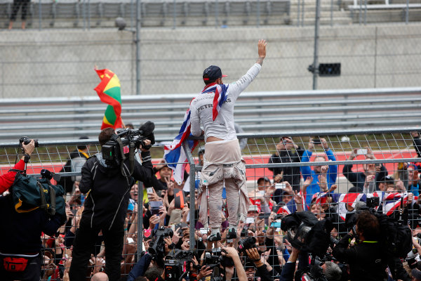 Circuit of the Americas, Austin, Texas, United States of America.  Sunday 25 October 2015. Lewis Hamilton, Mercedes AMG, 1st Position, celebrates with the fans. World Copyright: Andrew Ferraro/LAT Photographic ref: Digital Image _FER0529