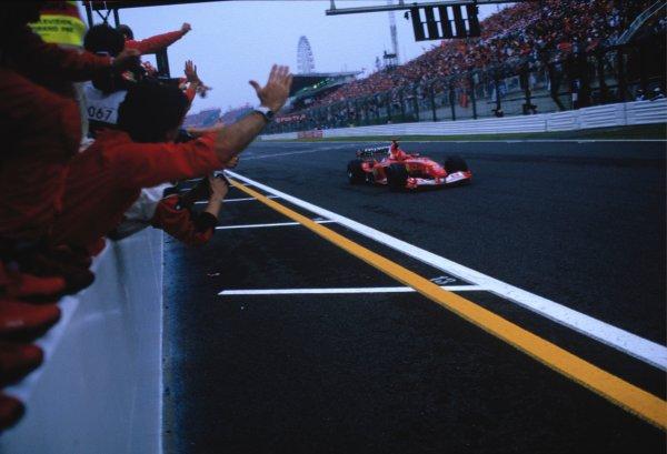 2003 Japanese Grand PrixSuzuka, Japan. 10th - 112th October 2003.Race winner Rubens Barrichello, Ferrari F2003 GA, crosses finish line.World Copyright: Steven Tee / LAT Photographic ref: 35mm Image 03JAP17