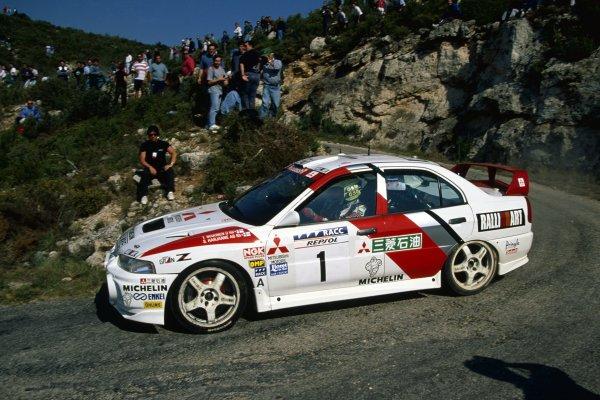 1997 World Rally Championship.Catalunya Rally, Spain. 14-16 April 1997.Tommi Makinen/Seppo Harjanne (Mitsubishi Lancer Evo4), 1st position.World Copyright: LAT PhotographicRef: 35mm transparency 97RALLY04