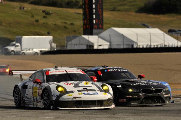 3-4 May, 2014, Monterey, California, USA 911, Porsche, 911 RSR, GTLM, Nick Tandy, Richard Lietz, 55, BMW, Z4 GTE, GTLM, Bill Auberlen, Andy Priaulx turn 11 pass for podium finish on final lap ©2014 Scott R LePage  LAT Photo USA