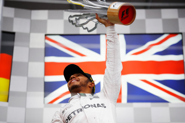 Circuit Gilles Villeneuve, Montreal, Canada. Sunday 12 June 2016. Lewis Hamilton, Mercedes AMG, 1st Position, with his trophy. World Copyright: Steven Tee/LAT Photographic ref: Digital Image _H7I5964