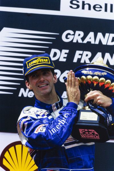 1996 French Grand Prix  Magny-Cours, France. 28-30 June 1996.  Damon Hill, Williams, 1st position, celebrates on the podium.  Ref: 96FRA02. World copyright: LAT Photographic