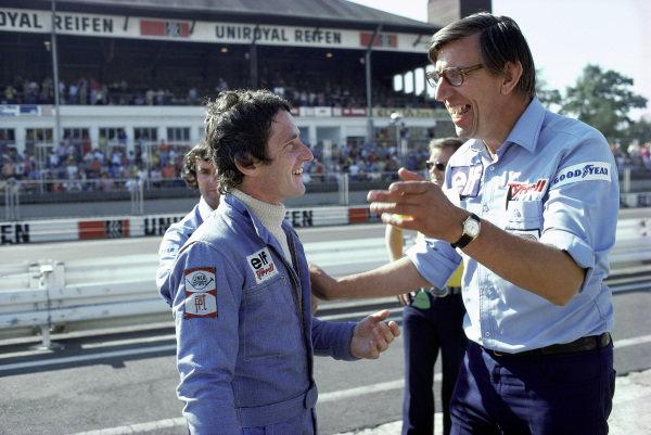 Patrick Depailler talks to team boss Ken Tyrrell.