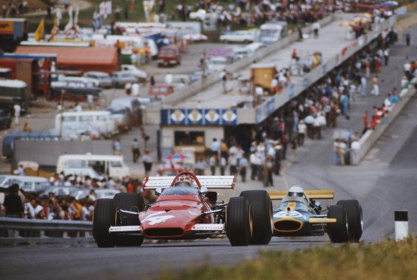 Ignazio Giunti, Ferrari 312B leads Jack Brabham, Brabham BT33.