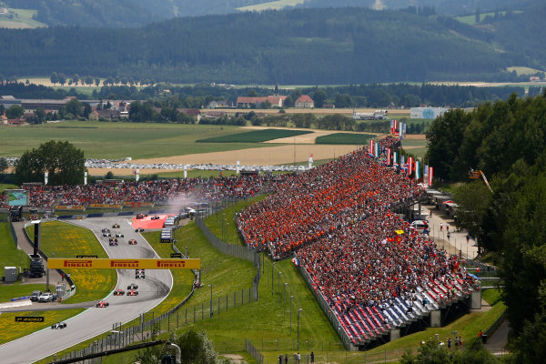 Red Bull Ring, Spielberg, Austria. Sunday 09 July 2017. Valtteri Bottas, Mercedes F1 W08 EQ Power+, lead Sebastian Vettel, Ferrari SF70H, Daniel Ricciardo, Red Bull Racing RB13 TAG Heuer, Kimi Raikkonen, Ferrari SF70H and Romain Grosjean, Haas VF-17. Behind, Daniil Kvyat, Toro Roso STR12 Renault. Max Verstappen, Red Bull Racing RB13 TAG Heuer, and Fernando Alonso, McLaren MCL32 Honda, recover from a first corner accident. World Copyright: Andy Hone/LAT Images ref: Digital Image _ONZ1434