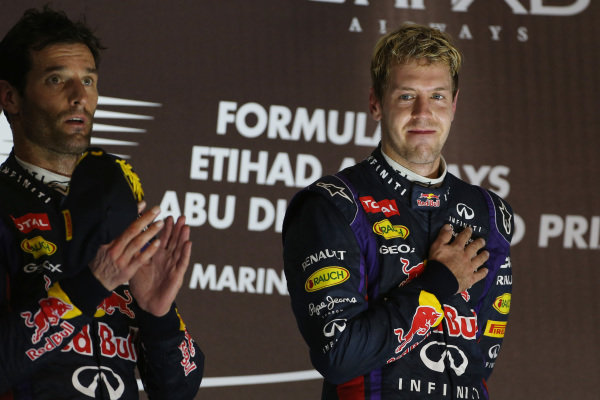 Race winner Sebastian Vettel (GER) Red Bull Racing and Mark Webber (AUS) Red Bull Racing celebrate on the podium. Formula One World Championship, Rd17, Abu Dhabi Grand Prix, Race Day, Yas Marina Circuit, Abu Dhabi, UAE, Sunday 3 November 2013. BEST IMAGE
