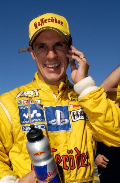 Laurent Aiello (FRA) Team Abt Sportsline, is being congratulated by mobile phone with another pole position.DTM Championship, Rd9, Zandvoort, Holland. 29 September 2002.DIGITAL IMAGE
