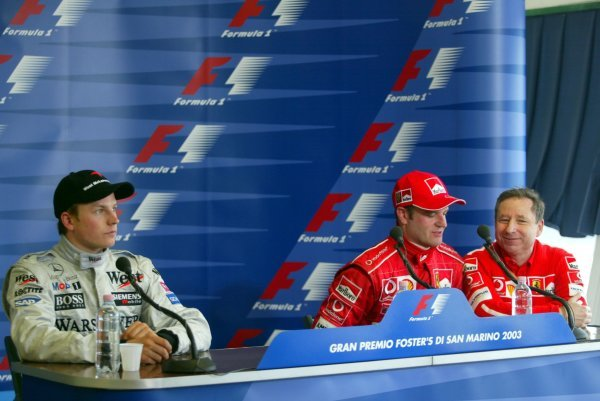 (L to R): Kimi Raikkonen (FIN) McLaren, who finished second; third placed Rubens Barrichello (BRA) Ferrari with Jean Todt (FRA) Ferrari General Manager, who substitited for race winner Michael Schumacher (GER) Ferrari in the press conference following the death of Schumacher's mother.Formula One World Championship, Rd4, San Marino Grand Prix, Race Day, Imola, Italy, 20 April 2003.DIGITAL IMAGE