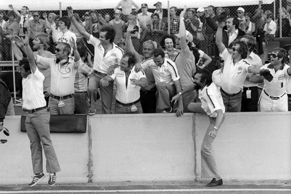 The Ligier team celebrate on the pit wall as Jacques Laffite (FRA) Ligier, wins his and the team's first GP.Swedish Grand Prix, Rd8, Anderstorp, Sweden, 19 June 1977.