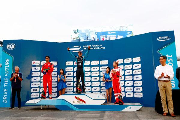 2016/2017 FIA Formula E Championship. Hong Kong ePrix, Hong Kong, China. Sunday 09 October 2016. Sebastien Buemi (9, Renault e.dams), Lucas di Grassi (11, ABT Schaeffler Audi Sport) and Nick Heidfeld (23, Mahindra Racing) on the podium. Photo: Zak Mauger/LAT/Formula E ref: Digital Image _L0U2540