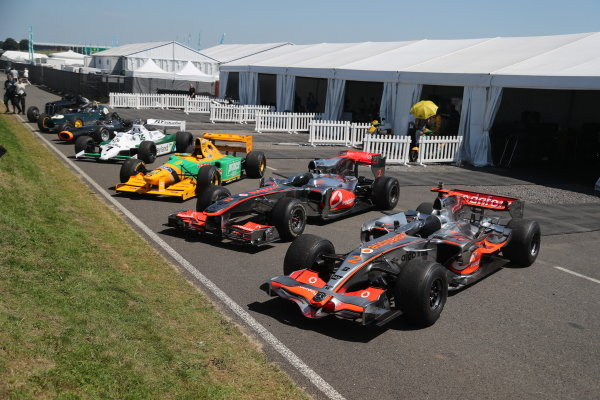 """A line-up of """"Best of British"""" racing cars, including an ERA, Lotus 16, BRM P261, Williams FW07C, Benetton B192 and classic McLarens"""