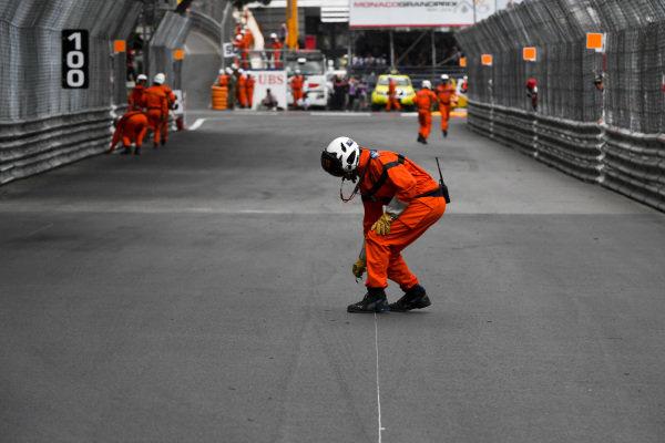 Marshal on track retrieving debris