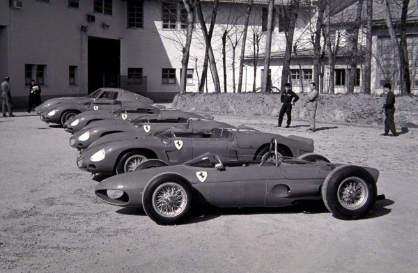 """A selection of racing Ferraris are displayed outside the Ferrari factory, including a Ferrari 156 """"Sharknose"""". Ferrari F1 Launch, Ferrari Factory, Maranello, Italy, 1962."""