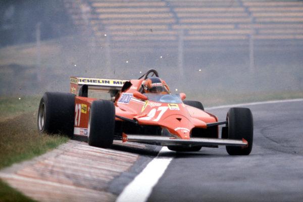 Gilles Villeneuve, Ferrari 126CK, corrects a slide as he runs wide onto the grass, kicking up sparks in the process.