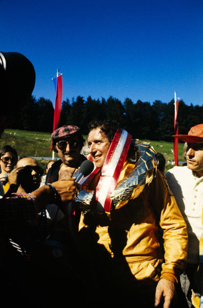 Vittorio Brambilla, 1st position, celebrates as he is interviewed.
