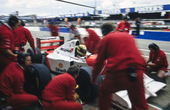 Ayrton Senna, McLaren MP4-8 Ford, makes a pitstop.