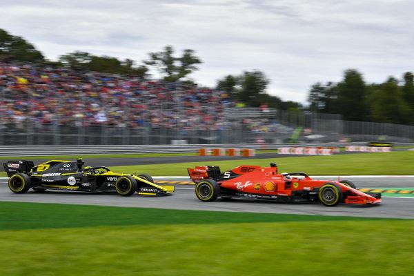 Sebastian Vettel, Ferrari SF90, leads Nico Hulkenberg, Renault R.S. 19